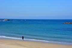 Japanese October Beach/Fukuok Ikinomathubara Beach. It is a famous beach with a white sand beach and a blue ocean. People who enjoy marine leisure in summer are royalty free stock images