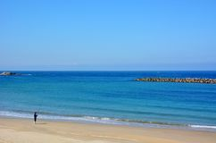 Japanese October Beach/Fukuok Ikinomathubara Beach. It is a famous beach with a white sand beach and a blue ocean. People who enjoy marine leisure in summer are stock photography