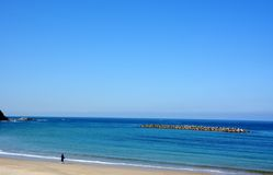 Japanese October Beach/Fukuok Ikinomathubara Beach. It is a famous beach with a white sand beach and a blue ocean. People who enjoy marine leisure in summer are stock image