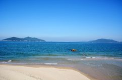 Japanese October Beach/Fukuok Ikinomathubara Beach. It is a famous beach with a white sand beach and a blue ocean. People who enjoy marine leisure in summer are stock images