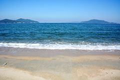 Japanese October Beach/Fukuok Ikinomathubara Beach. It is a famous beach with a white sand beach and a blue ocean. People who enjoy marine leisure in summer are stock photos