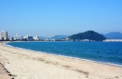 Japanese October Beach/Fukuok Ikinomathubara Beach. It is a famous beach with a white sand beach and a blue ocean. People who enjoy marine leisure in summer are royalty free stock photos