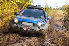 Japanese off-road car moving through deep mud Royalty Free Stock Photography