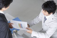Japanese office worker. BUSINESS IMAGE-two office workers discussing about the documents Royalty Free Stock Photography