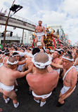 Japanese Ogion festival participants. Kagoshima City, Japan, July 19, 2009. Participants of the Ogion festival carry a heavy portable shrine which has one of royalty free stock image