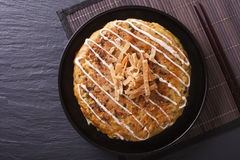 Japanese okonomiyaki pizza close-up. horizontal  top view Stock Photography