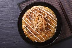 Japanese okonomiyaki pizza close-up. horizontal  top view Stock Photography