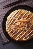 Japanese okonomiyaki pizza close-up. vertical top view Stock Photography