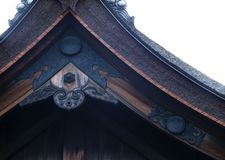 Japanese old shrine entrance roof black wooden decoration background stock photo