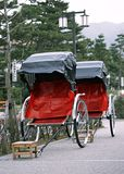 Japanese old and traditional tourist red and black rickshaw royalty free stock image
