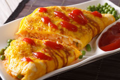 Japanese omelet with rice Omurice close-up on a plate. Horizonta Stock Photography