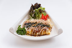 Japanese Omelette with Okonomiyaki Sauce. Royalty Free Stock Photography
