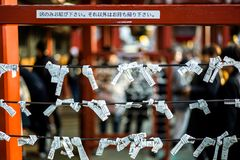 `sacred lottery` in Japanese shrine. Japanese Omikuji or sacred lottery in Japanese shrine. random fortunes written on strips of paper at Shinto. Buddhism is the Stock Photos