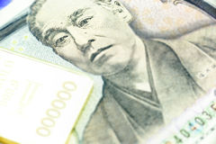 Japanese one thousand yen note, a macro close-up with gold bulliion Stock Photo