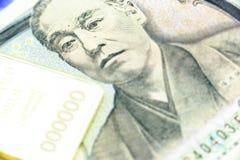 Japanese one thousand yen note, a macro close-up with gold bulliion Stock Photo
