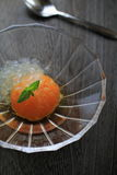 Japanese orange compote. Dessert made of whole Japanese tangerine in sugar syrup Stock Photography