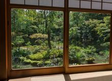 Japanese oriental green stone garden view. With window and tatami Stock Photo