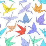 Japanese Origami paper cranes symbol of happiness, luck and longevity, sketch seamless pattern. purple blue yellow orange red brow. N green line on white Royalty Free Stock Image