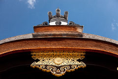 Japanese ornate roof ornament against blue sky Royalty Free Stock Photo