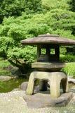 Japanese outdoor stone lantern in zen garden Stock Photos