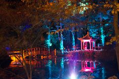 Japanese Pagoda and Footbridge. Japanese Pagoda and wooden footbridge, illuminated in the forest to celebrate Diwali, the traditional Indian `Festival of Lights Stock Image