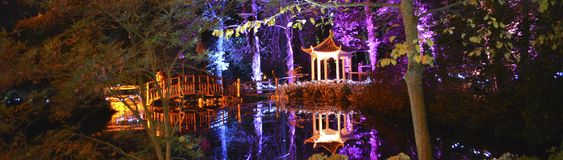 Japanese Pagoda and Footbridge. Japanese Pagoda and wooden footbridge, illuminated in the forest to celebrate Diwali, the traditional Indian `Festival of Lights Stock Photography