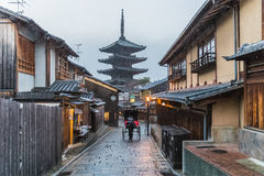 Japanese pagoda and Old house. In snow falling day  at Kyoto prefecture Royalty Free Stock Photo