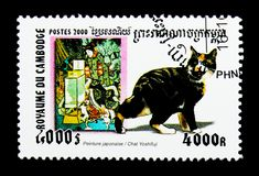 Japanese Painting, Domestic Cat Felis silvestris catus, Cats and Art serie, circa 2000. MOSCOW, RUSSIA - NOVEMBER 24, 2017: A stamp printed in Cambodia shows Royalty Free Stock Photos