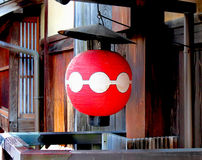 Japanese paper lantern. A red Japanese paper lantern outside a building in the Gion District of Kyoto, Japan Royalty Free Stock Photos