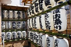 Japanese paper lanterns lined up on bamboo rafts with Japanese writings and hangs beside a temple in Tokyo, Japan. TOKYO, JAPAN - April 30, 2017, Japanese paper Royalty Free Stock Photography
