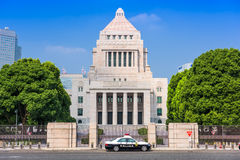 The Japanese Parliament Building. TOKYO, JAPAN - JULY 31 2015: A police crusier below The National Diet Building of Japan Royalty Free Stock Photo