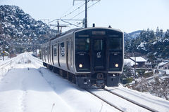 Japanese passenger train on a snowy day Stock Photos