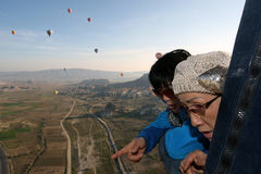 Japanese passengers in a hot air balloon above Goreme in Turkey. Stock Photo