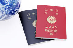 Japanese passport and earth globe Royalty Free Stock Photo