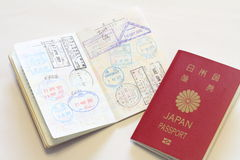 Japanese passport and visas on the passport. (red Royalty Free Stock Image