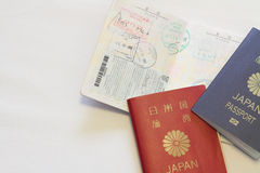 Japanese passport and visas on the passport. (red Royalty Free Stock Photo