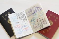 Japanese passport and visas on the passport. (red Royalty Free Stock Photography