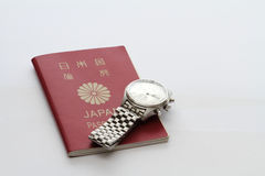 Japanese passport and watch Stock Images