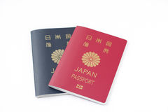 Japanese passport on white isolate background. Two red and navy Japanese passports on white isolate background Royalty Free Stock Photos