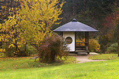 The Japanese pavilion in the park. Gazebo in the Japanese design classic in the autumn park Royalty Free Stock Photo