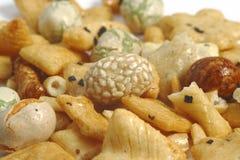 Japanese peanut crackres. On the white background Stock Photography
