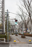 Japanese pedestrian crossing light. In the urban area Stock Images