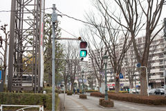 Japanese pedestrian crossing light. In the urban area Stock Photo