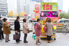 Japanese people buying lottery Royalty Free Stock Photos