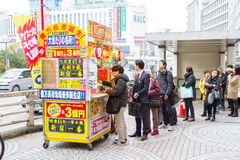 Japanese people buying lottery. OSAKA JAPAN - DEC 11, 2015: Japanese people buying lottery at the counter. Japanese lottery offers a form of entertainment for Stock Photo