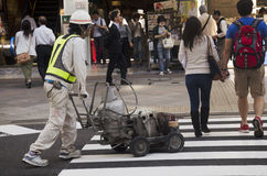 Japanese people in construction site working and repair surface Royalty Free Stock Photography