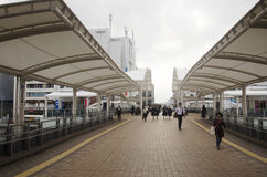 Japanese people and foreigner traveler walking on footbridge at. Saitama railway station on October 19, 2016 in Saitama, Japan stock photo