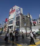 Japanese people and foreigner travelers walking crosswalk traffi Stock Image