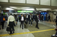 Japanese people and foreigner travelers walking entrance and exit gate for passenger train at Shinjuku station. On October 19, 2016 in Tokyo, Japan royalty free stock image