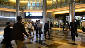 Japanese people and foreigner travelers walking at Tokyo railway station. TOKYO, JAPAN - OCTOBER 20 : Japanese people and foreigner travelers walking entrance stock video footage